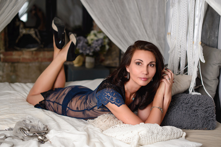 woman 50 years old posing on bed